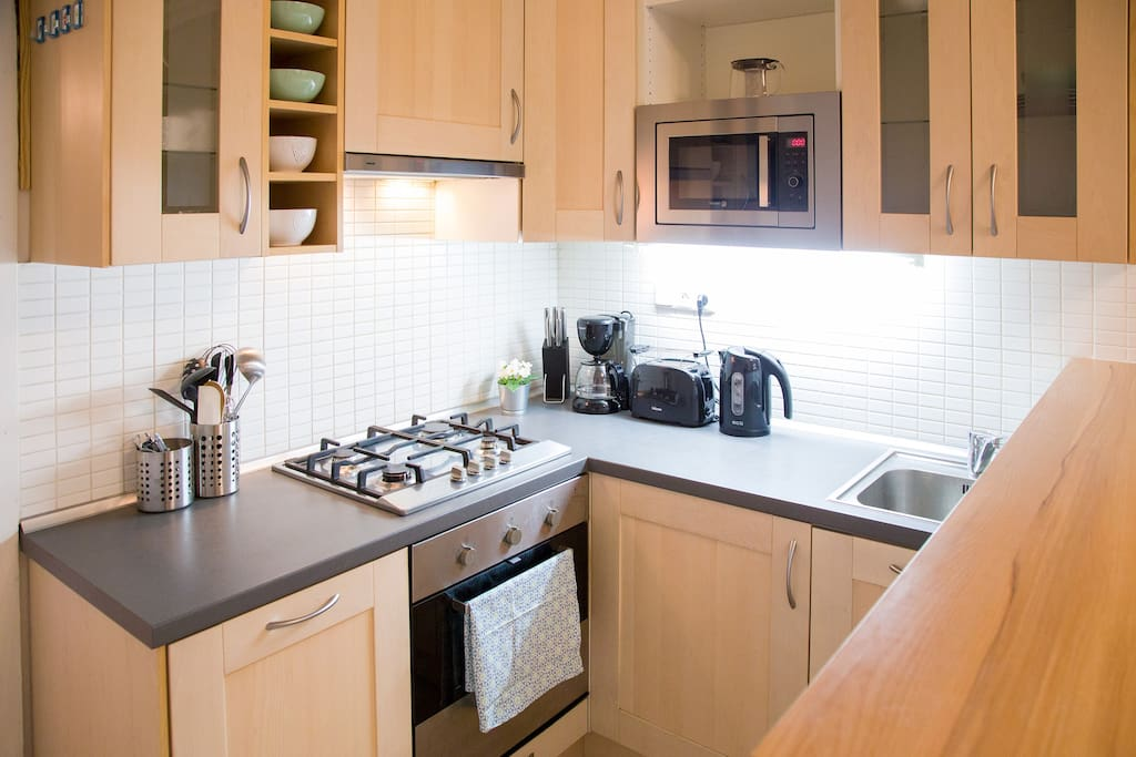 Fully-equiped kitchen, dishwasher, oven, stove, microwave oven, kettle, coffee maker, toaster...