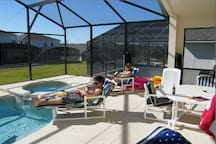 Large south facing pool area with gas BBQ, safety fence and Lanai.