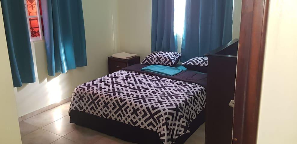 Bedroom with 1 Queen bed, plenty of storage