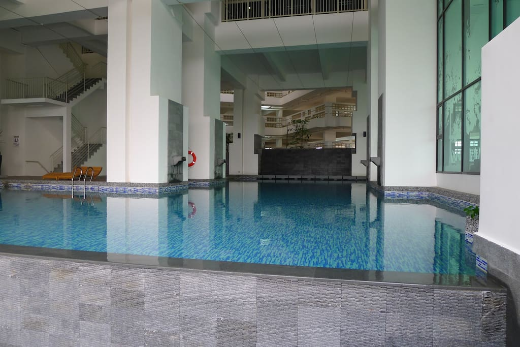 Adult pool is adjacent to the play pool