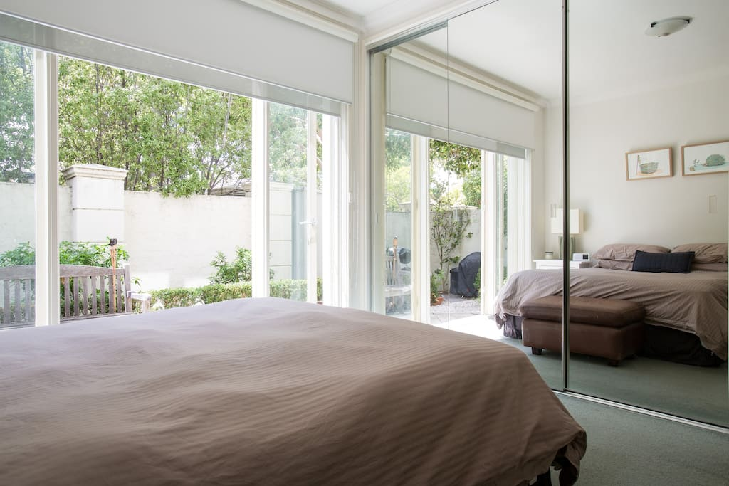 Bedroom with beautiful natural light & opening on to the courtyard