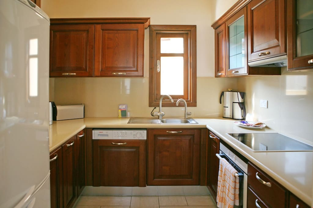 Make a delicious meal in the kitchen with a variety of appliances including a dish washer.