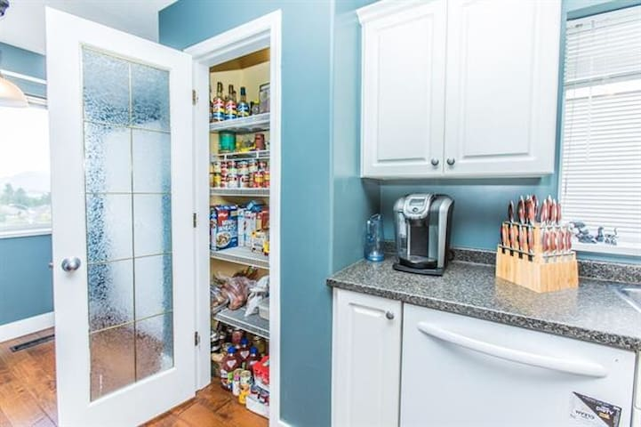 Help yourself to Kraft dinner, Zoodles, Tuna, coffee, tea, and basic condiments like sugar, salt, and ketchup.