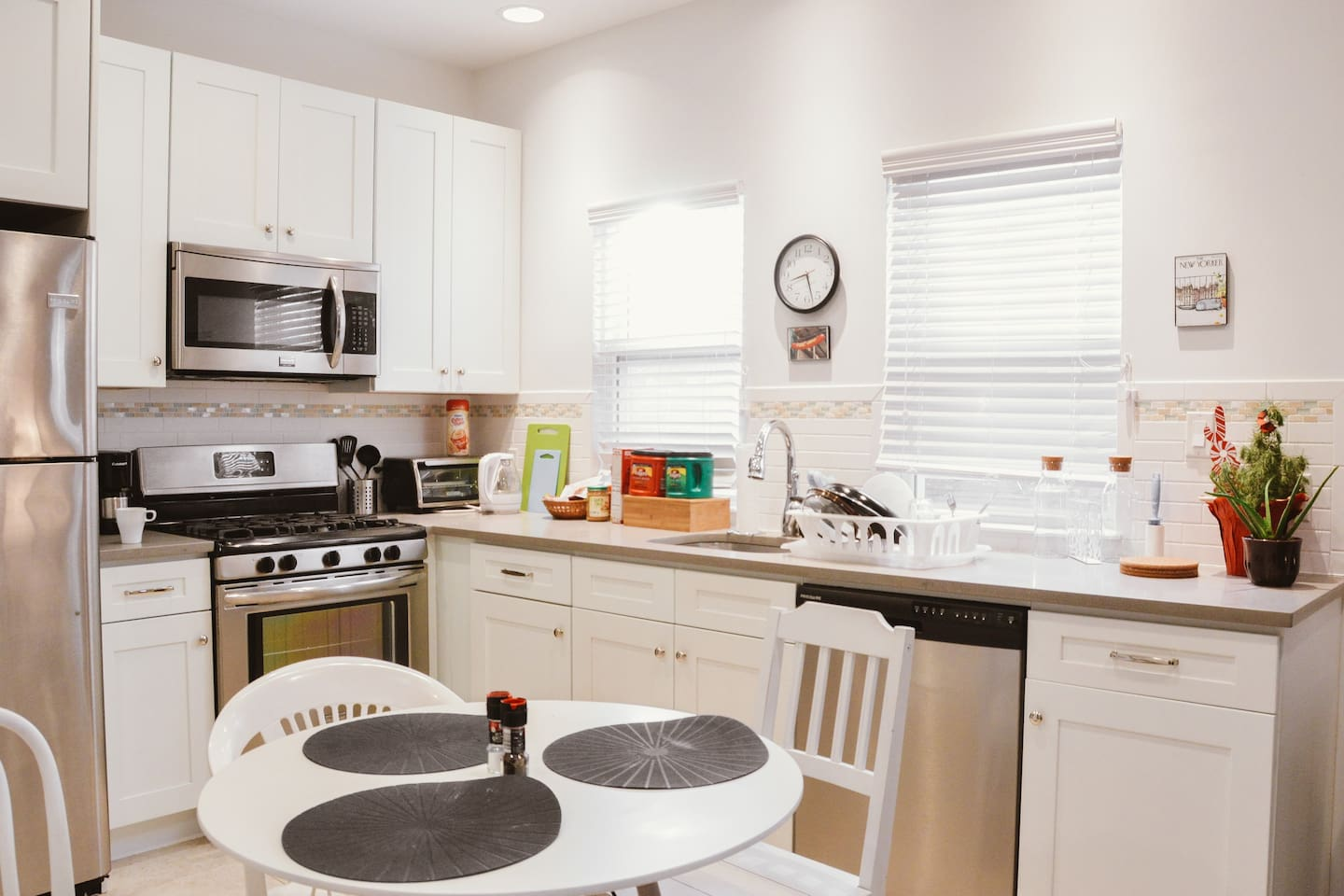 The kitchen is the center of the apartment.  It has a 5 burner stove, an oven, a microwave, a toaster oven, a  dishwasher, a full sized refrigerator, and two coffee makers.