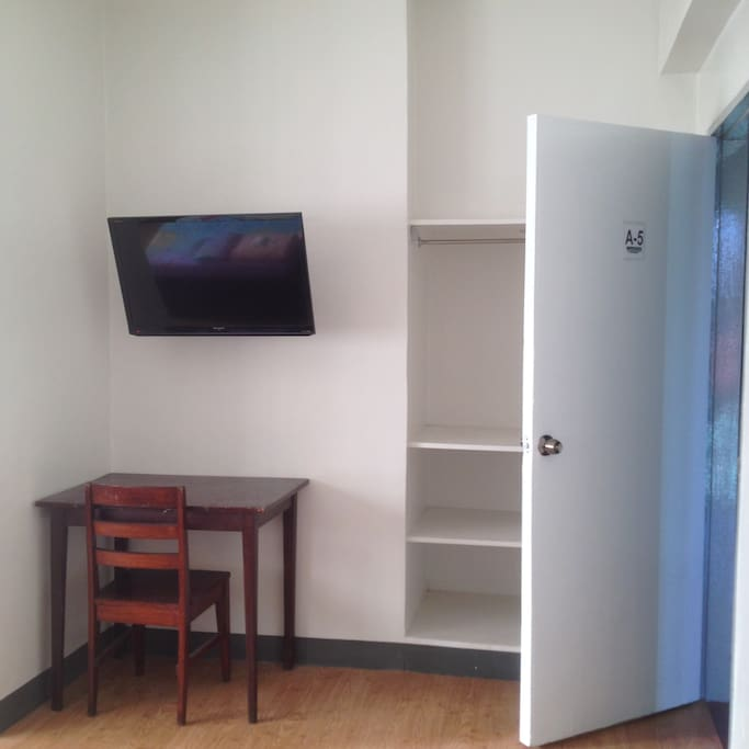 laptop area, 32 inch flat screen tv and closet space