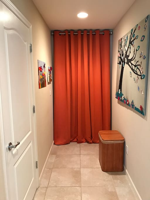 Some fun art and the closet with a stackable washer and dryer laundry soap and fabric softeners for your exclusive use.