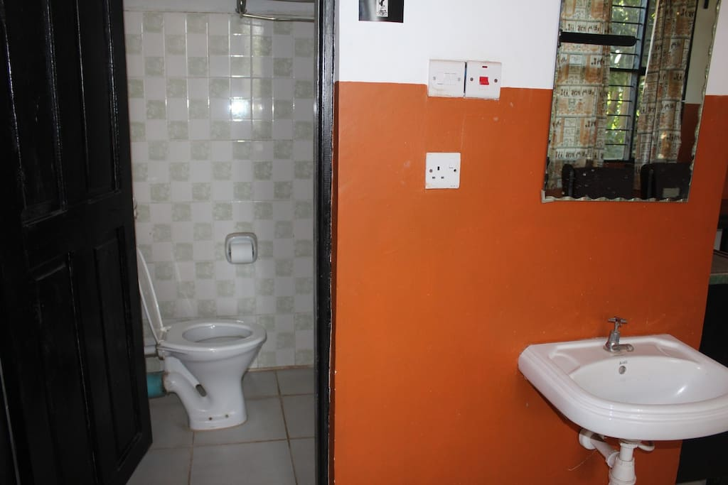 toilet and shower with sink outside bathroom