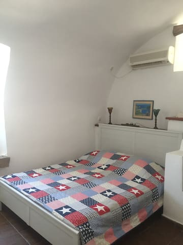 the bedroom with double bed