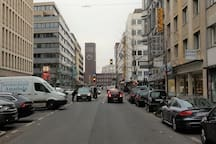 some parkings and the central station at the end of the street