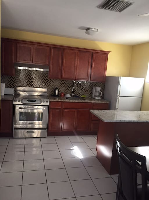 Newly remodeled kitchen with granite counter tops; fully equipped with cooking and serving items.