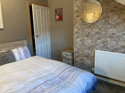 Double room with king sized bed and smart tv.