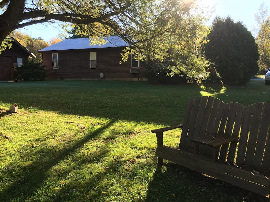 Adirondack chairs near pond.