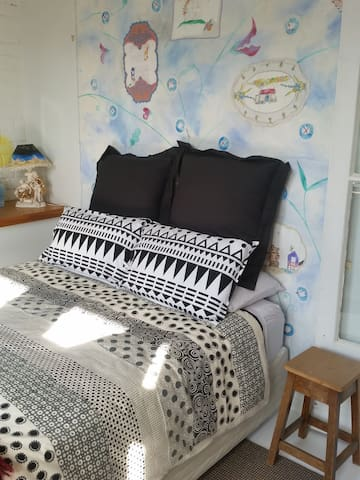 Sleep surrounded by original art in a cosy & comfortable bed.