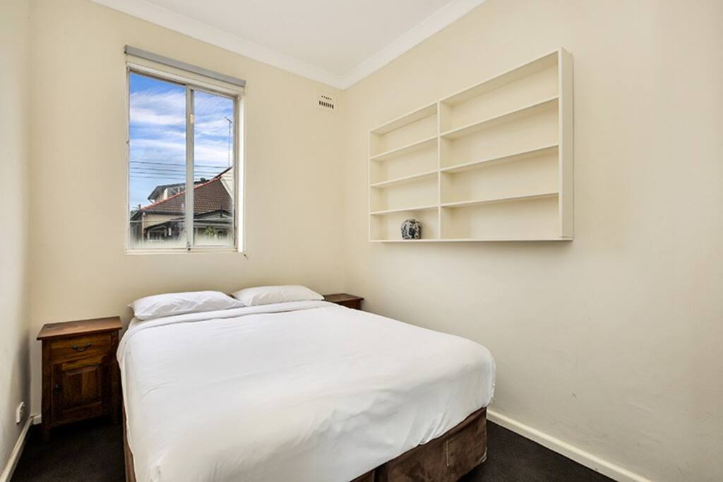 Main bedroom with Queen sized bed & built-in wardrobe