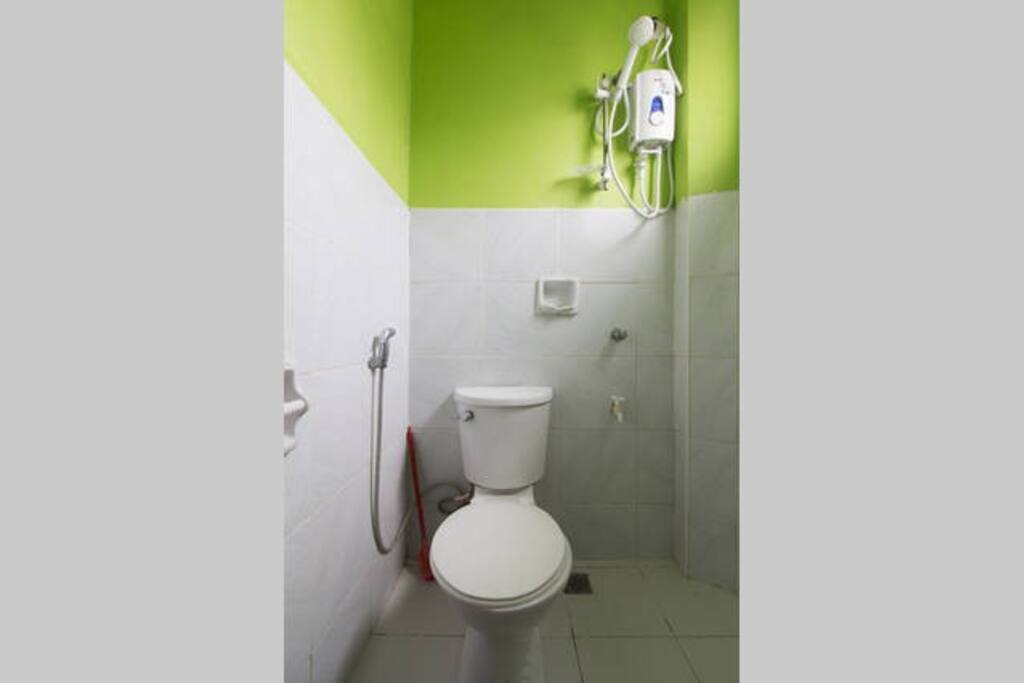 Tiled private toilet with Hot/Cold shower.