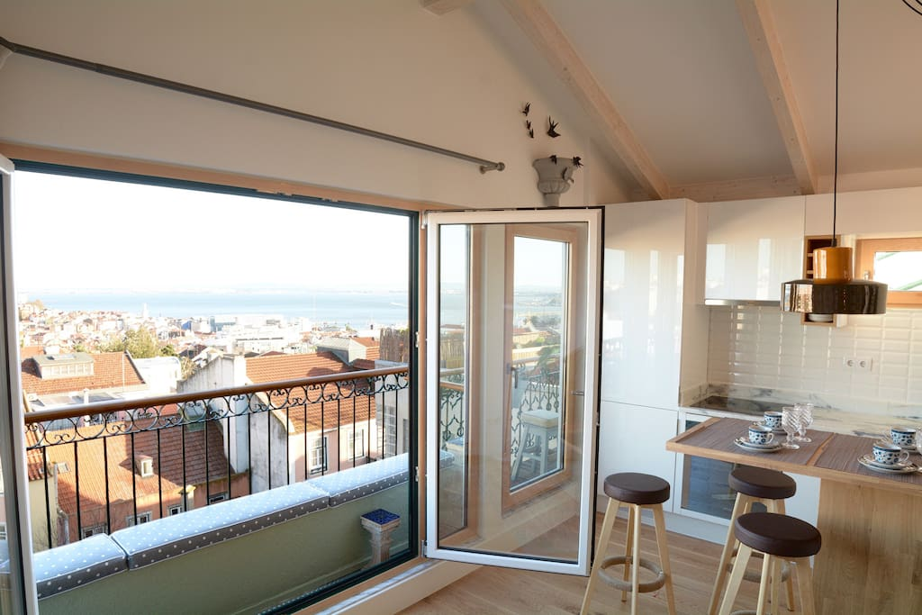 Big window with great views over Lisbon, River and South side