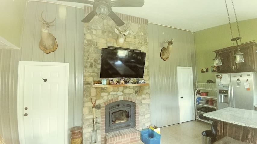 Living Room with Direct TV, wood burning fireplace and surround sound speaker system.