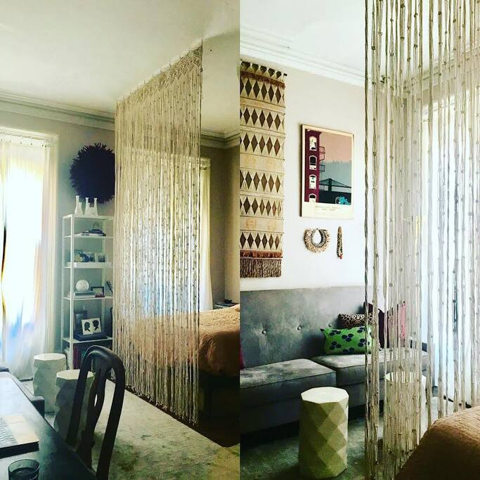 custom textile curtain that separates the living from sleeping areas.