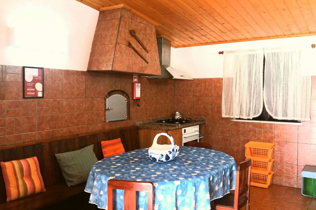 Typical kitchen with wood oven and gas oven