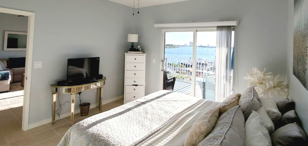King bed master suite. Direct access to patio. Watch the water or cable TV from the bed. A large closet, vanity area and private master bath are connected