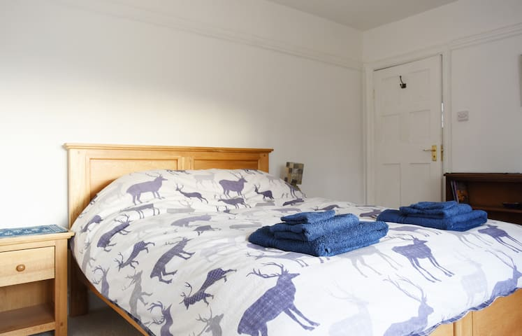 This is your lovely double bed room with high quality linens overlooking our massive meandering garden.  The house is on top of a hill so your room will give you extensive views.