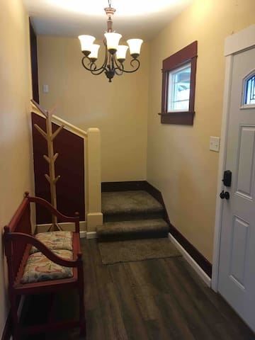 Shared entry with keypad, staircase leads to security door and apartment.