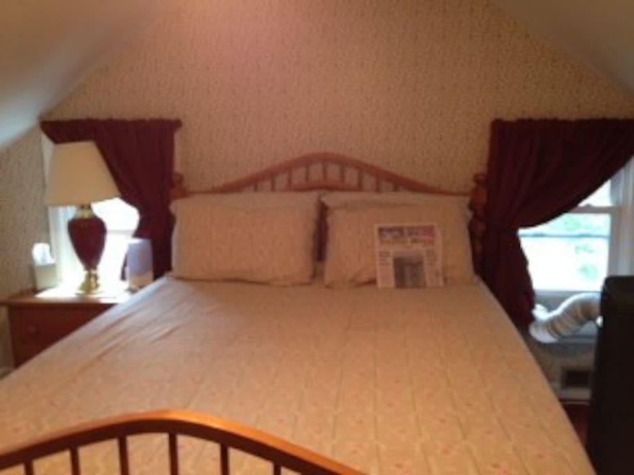 Queen bed in cozy, private room on third floor.