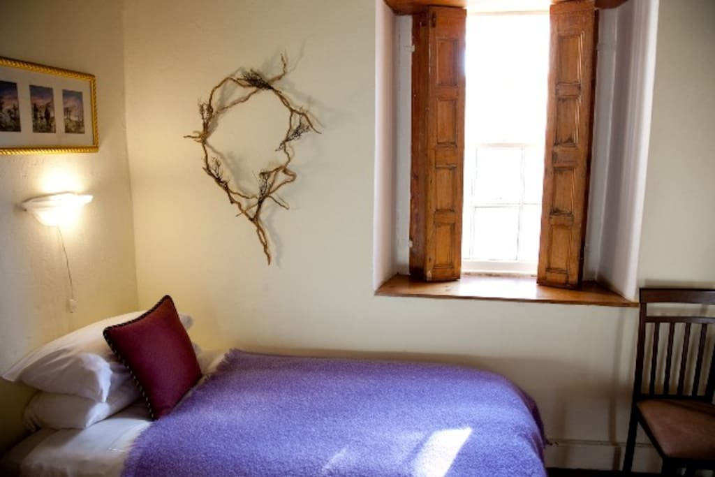 The Courtyard room sleeps 3, a Queen-sized bed and a single bed.