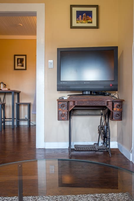 The T.V. sits on an antique sewing machine. The apartment is equipped with Direct T.V. and wifi.