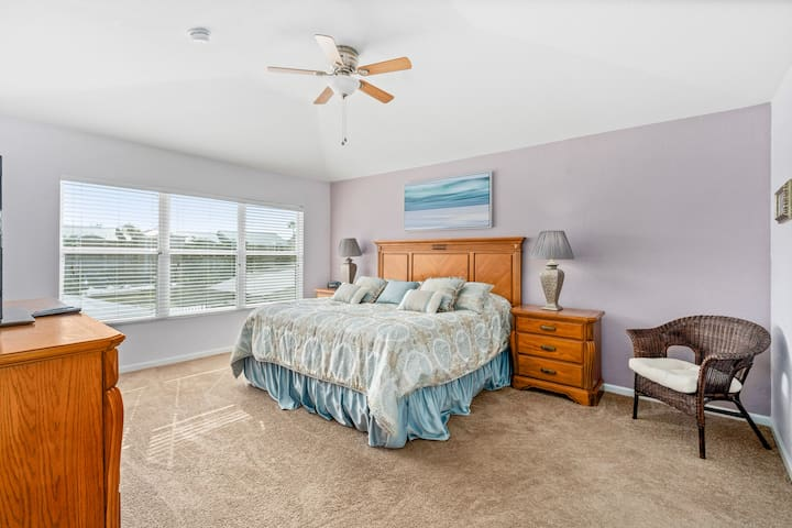 Master bedroom with comfortable king bed and ensuite bathroom
