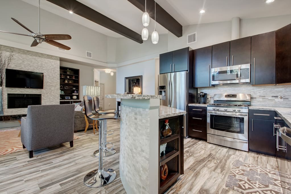 This luxury kitchen opens up to the living and dining room.