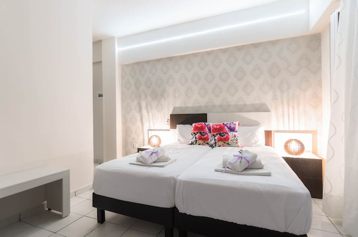 Open plan air-conditioned room with 1 double bed or 2 single beds