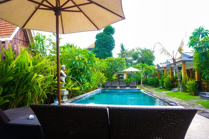 Comfortable Double bed with  pool  and Garden View