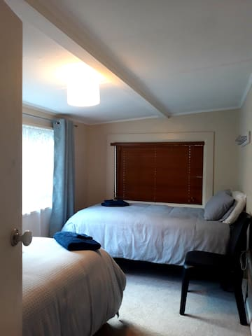 Bedroom 3, single and king single beds.