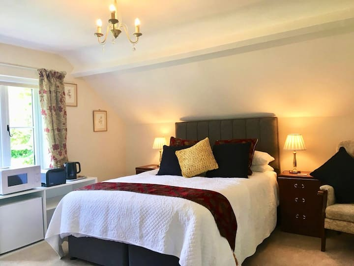 Kingsize EnSuite bedroom with view of distant hill