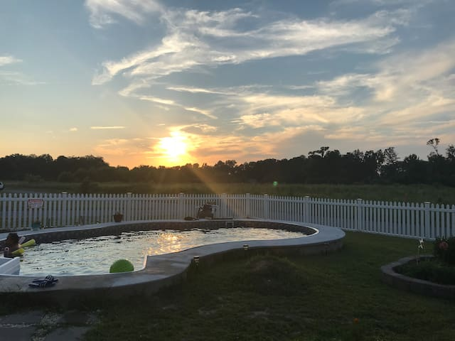 Enjoy the beautiful sunset from the pool area