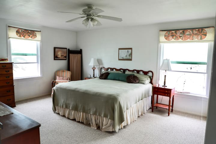 Master bedroom with private bath. Carpet has been removed and replaces with new flooring.