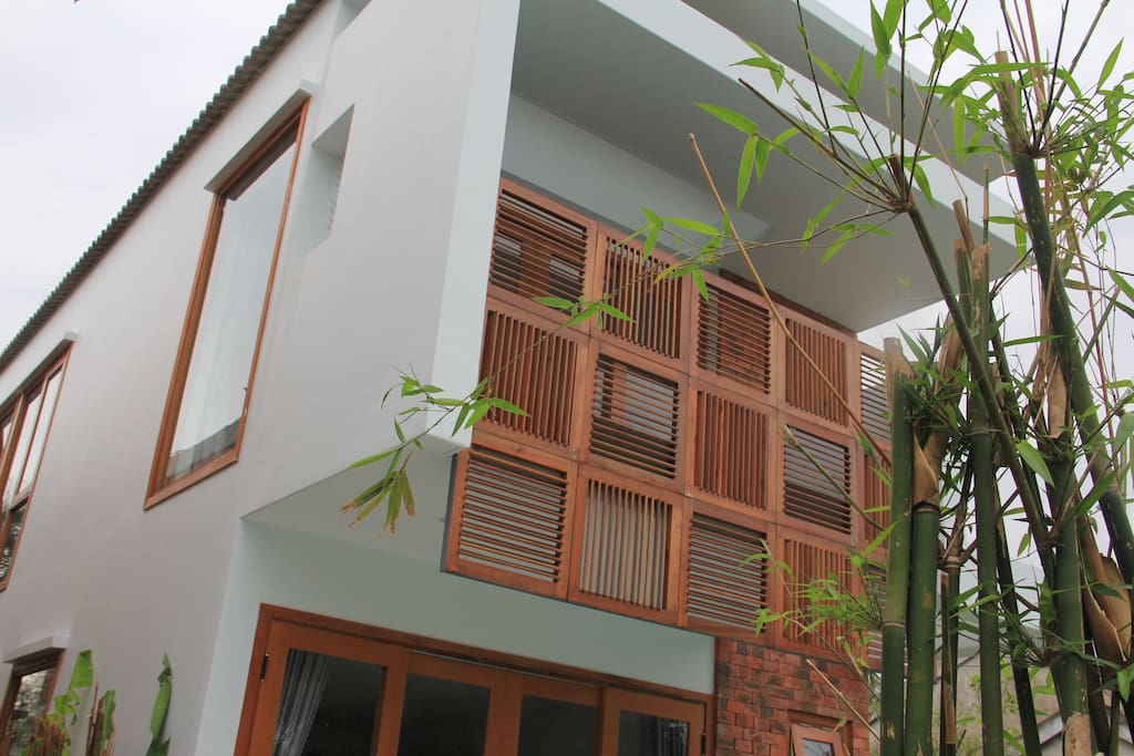 Front of villa with adjustable wooden sun screens