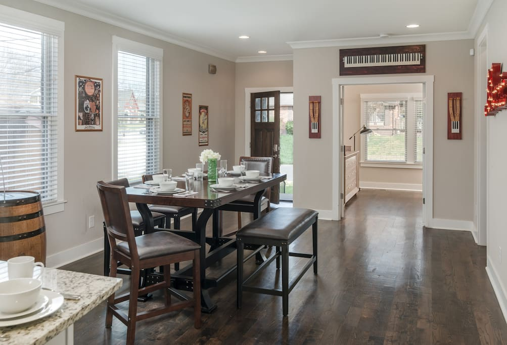 Enter into the open dining room with hardwood floors