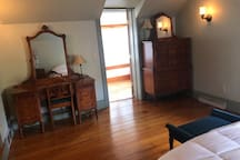 Upstairs bedroom. The fourth bedroom is beyond the door.