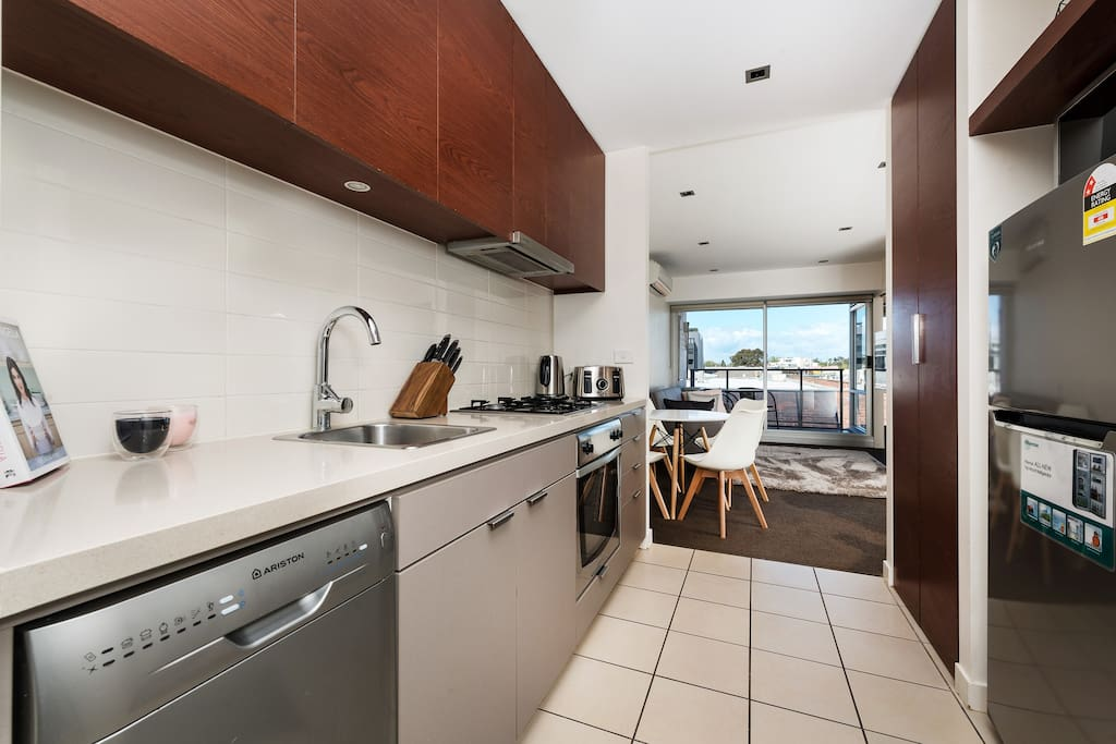 Modern fully equipped kitchen with laundry