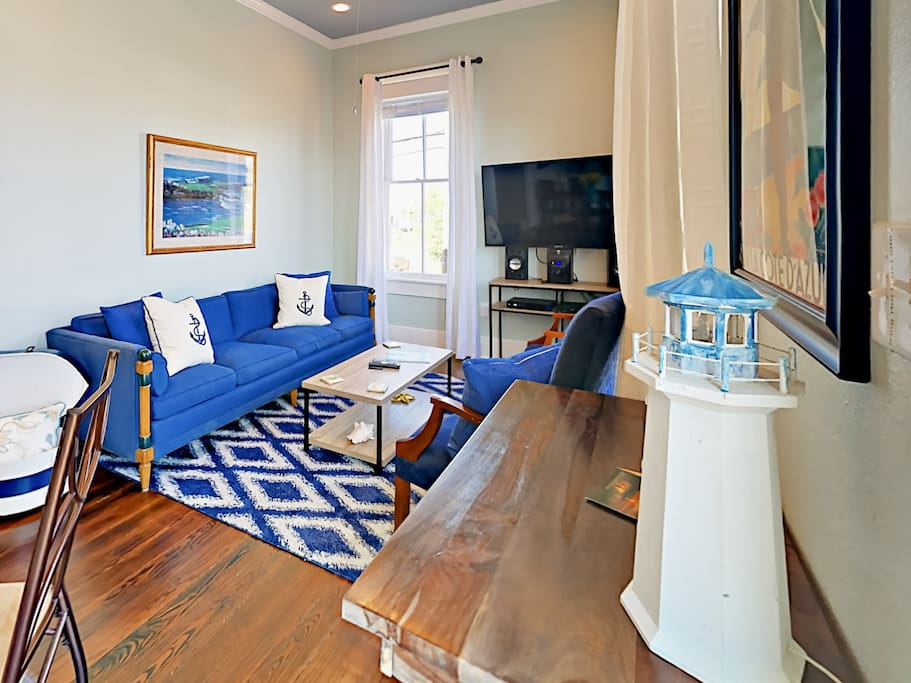 Your rental has a beach-chic decor and seating for 5 in the living room.