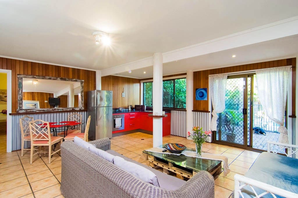 Spacious lounge with entrances to pool, garage and private courtyard