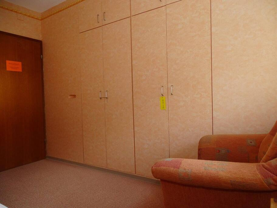 Cupboard,armchair,orange room