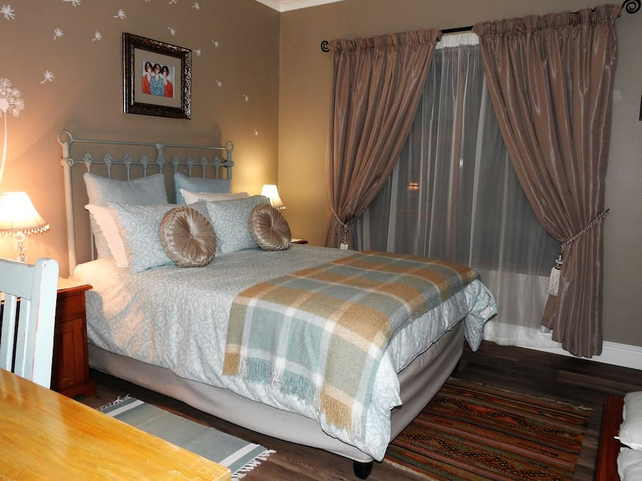 Comfortable double bed and television with all DSTV channels in the room.