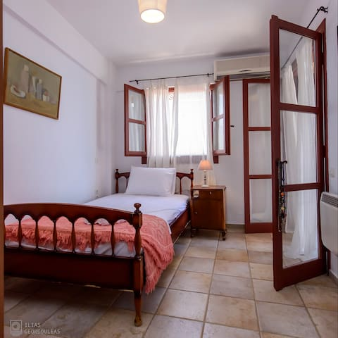 The third bedroom on the top floor with the large single bed, upstairs
