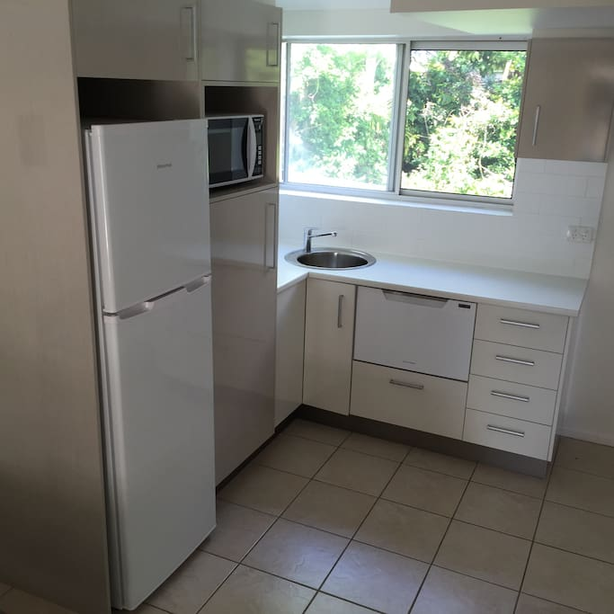 Good size fridge and freezer, drawer dishwasher, electric frying pan, microwave, toaster,sandwich maker, coffee plunger, electric cook top, all crockery and cutlery