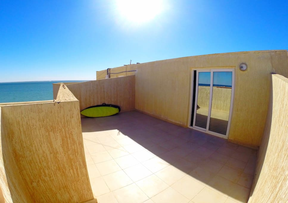 The outside patio space for BBQ, sunbathing,board storage, yoga, or watching the sunrise!