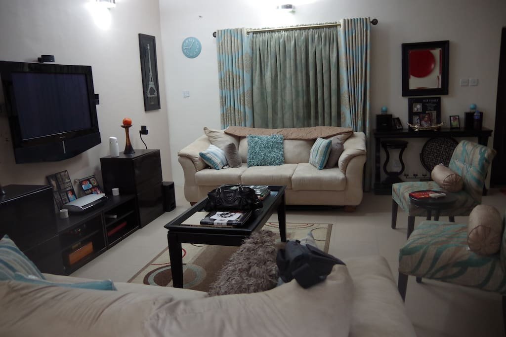Lovingly decorated living room with 42 inch tv and Bose surround sound system for guest to relax after a long day.