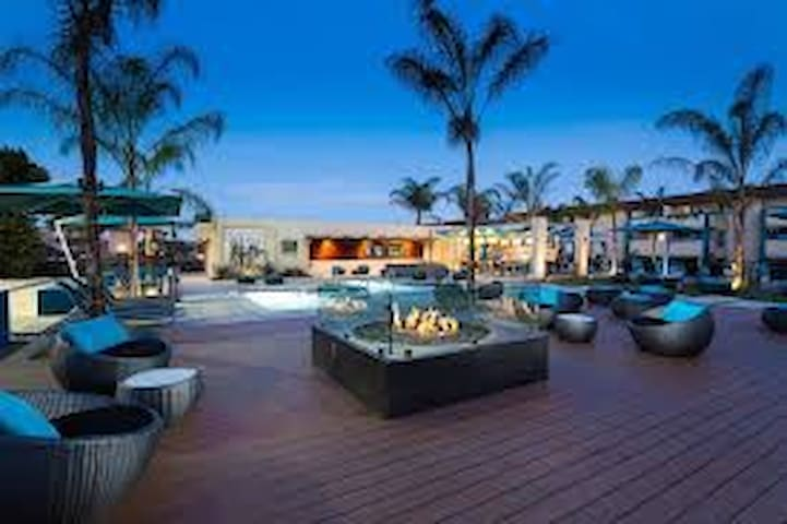 Pool, hot tub, fire pit, outdoor TVs, grills, sand volley ball court, basketball and tennis courts